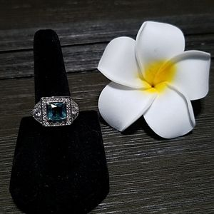 Silver tone ring with light blue stone